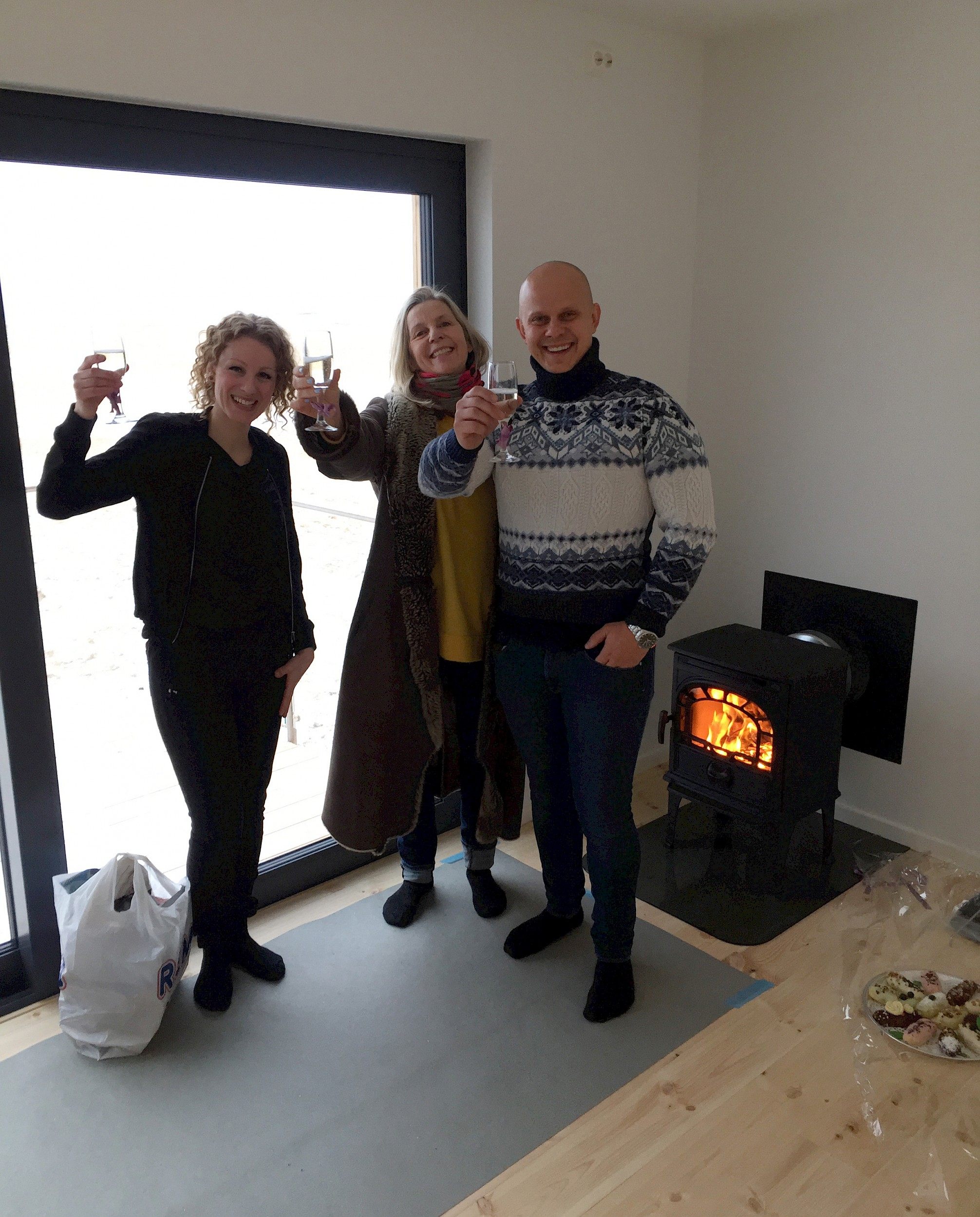 Audhild Dahlstrøm, A K Dolven and Andrius from TMS Bygg celebrate the handover of the MJF building